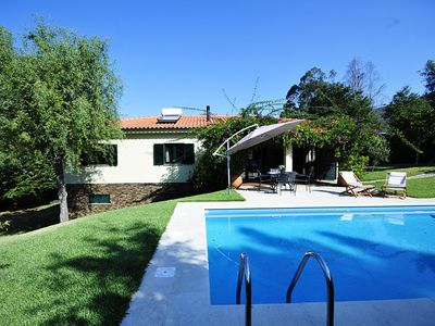 Photo for 4 bedroom Villa, sleeps 8 in Venade with Pool and WiFi