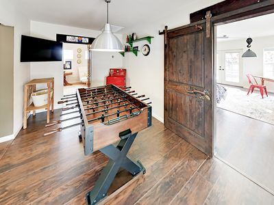 2nd Living Room - Enjoy a fun game of foosball while watching the game on the flat-screen TV.