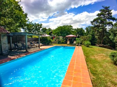 Photo for Large and beautiful property in the woods with 15m heated swimming pool