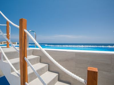 Photo for Contemporary Apartment with un-obstructed Sea Views and Private Infinity Pool