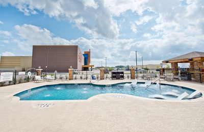 Dive into the pool after a day of fun.