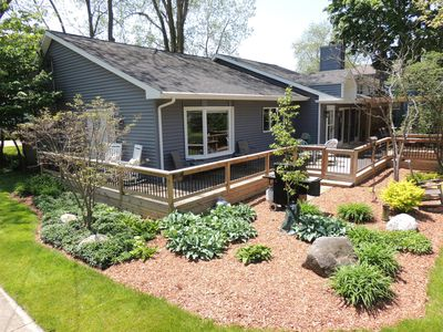Beautiful landscaping surrounds the spacious wrap-around deck
