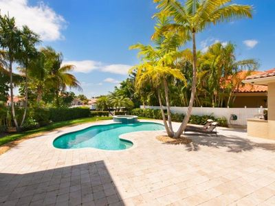 Photo for Beautiful Corner Waterfront House With Lush Surroundings & Pool