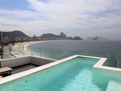 Photo for Rio067 - Three bedroom penthouse beachfront in Copacabana