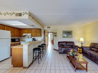 Beach condo with shared pool & private balcony, walking distance from the waves