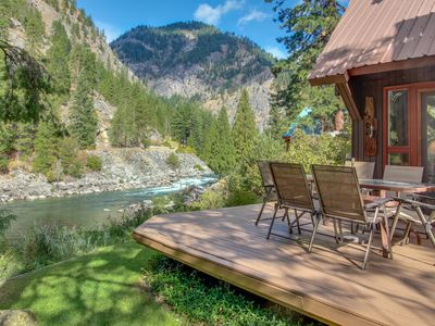 Photo for Picturesque riverfront home w/private hot tub, stunning river views!
