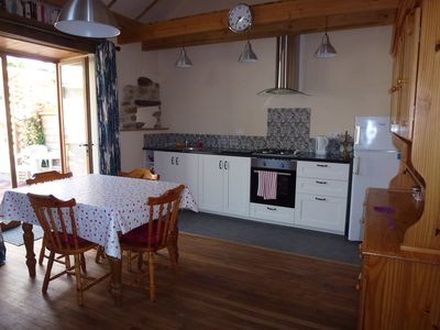 Open plan kitchen/dining area with patio doors to private garden & patio
