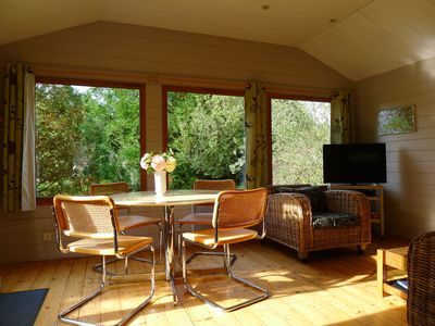 Photo for 2 kms from the beach of Deauville, pretty chalet located in an independent park