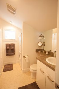 Bathroom with shower, washer, and dryer.