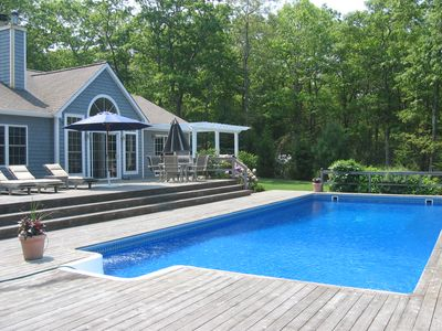 Oversized heated pool with large deck, hot tub and outdoor shower