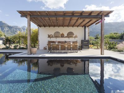Photo for Exclusive designer stone villa with views over the mountains