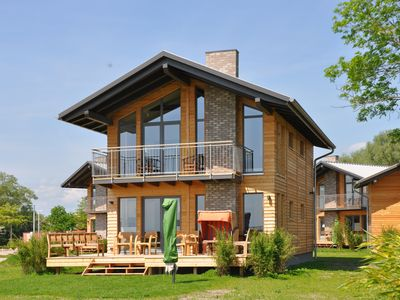 Photo for Modern holiday home with sea view for 6 people, just 80 meters from the beach