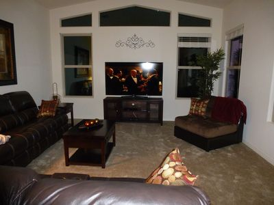 Living Room, complete with reclining sofas and 65' Smart TV