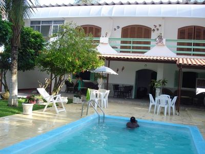 Photo for Triplex house with outdoor terrace facing the sea at 20 meters from the beach Macumba