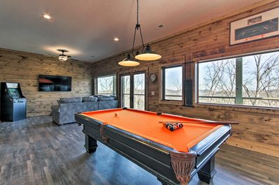 This high-end mountain home offers 5 bedrooms, 3.5 baths and a game room.