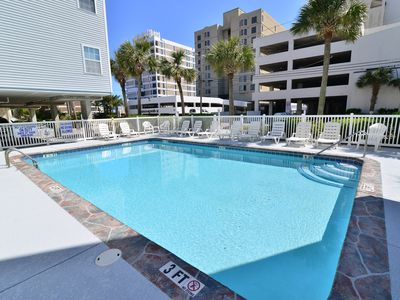 Photo for GORGEOUS ALL-NEW Condo OCEAN PEEK! Pool + TOP LOCATION + Grill & Chill!