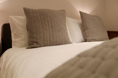 Comfortable double bed with luxurious crisp linen
