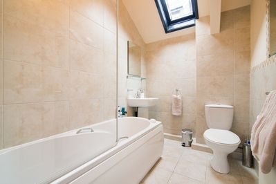 Bathroom with instant hot water from new condensing boiler.