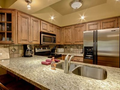 Photo for In the middle of it all! 4 bedroom condo, walk to slopes! Shuttle 2 Main!