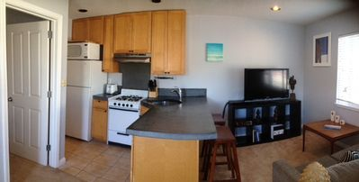 Photo for Sounds of the ocean drift into this cozy 1 bedroom apartment