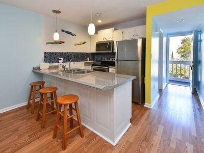 Photo for Totally Remodeled Bright and Beautiful  2bed 2 bath condo just steps to the Beac