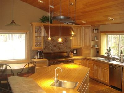 Large island in center of kitchen with extra sink