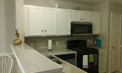 Kitchen with all appliances - Dishwasher, Stove, Microwave