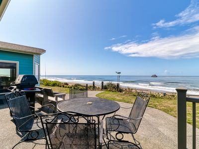 Photo for The Beach House  - with a fenced yard, furnished patios & steps from the beach!