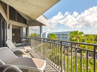 Photo for Colorful beachfront condo w/ ocean view balcony & shared hot tub/pool/tennis!