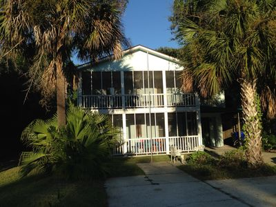 Porches and Palmettos make this home a perfect destination.