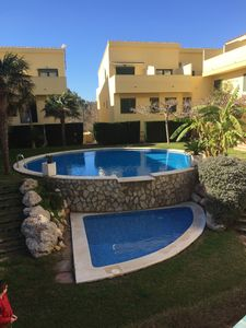 Photo for Lovely 4 Bed 3 Bath Family Townhouse with air con 5 min walk from Arenal beach
