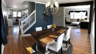Beautiful home with authentic wood dining room table ready for your stay!