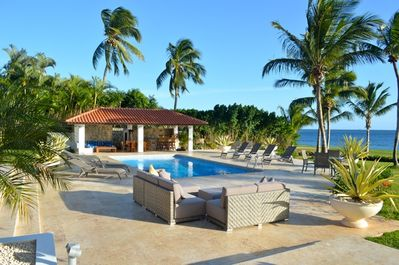 Comfortable outdoor seating around pool and jacuzzi