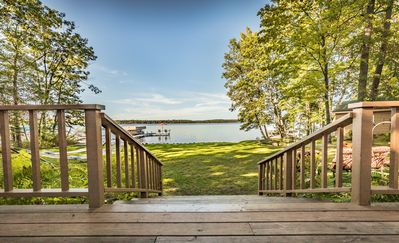 Steps off the large deck bring you down to the lawn, lake and dock