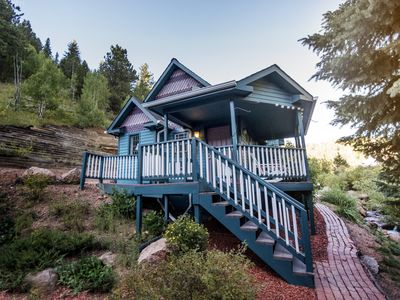 Photo for A private romantic getaway complete with a porch swing and reading nook...