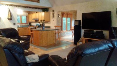 Photo for Very private, log sided, lakefront home located in a private wooded setting,
