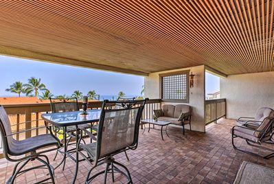 The 1-bedroom, 1-bath corner unit hosts a spacious balcony and sleeps 4 guests.