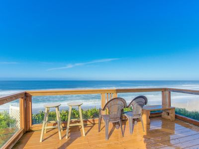 Charming oceanfront two-story home w/private hot tub in deck, gas grill, & views