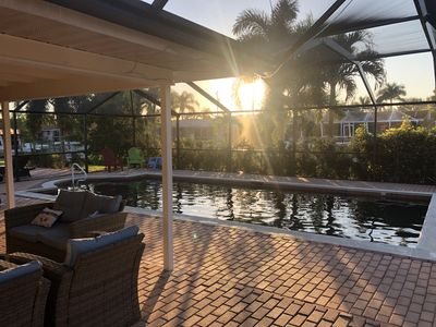 Photo for Villa 4 bedrooms2 bath, large heated salt water pool, fish ,boat, dock on canal