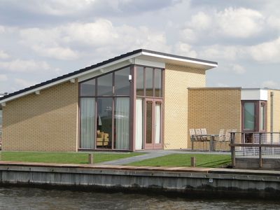 Photo for Holiday house for 4 persons with private dock at a marina park Lemmer