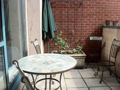 Private sun-drenched patio with BBQ