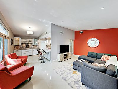 Living Area - Contemporary decor with pops of color creates a warm vibe throughout the home.