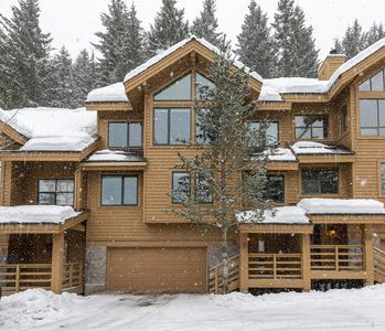 Photo for 4 bedroom plus TV area townhome next to the ski runs with private hot tub!
