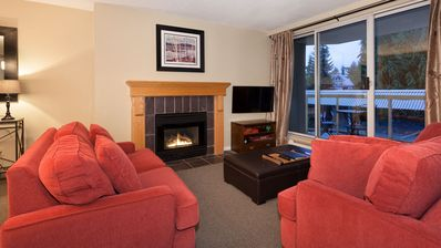 """Cozy living area with gas fireplace and 40"""" LED SMART TV"""