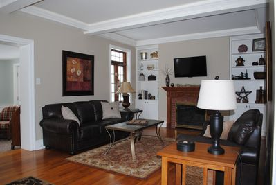Cozy Main living room with flat screen TV above the fireplace