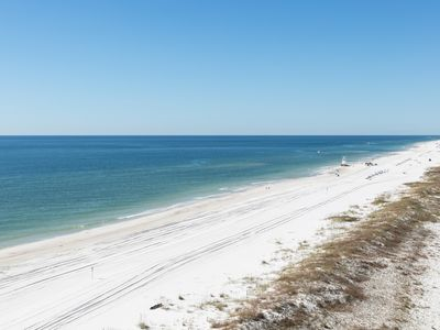 Photo for Stunning beachfront condo w/ a full kitchen, private balcony, & shared pools!