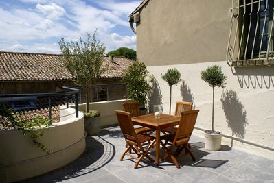 Sunny 25m2 terrace with dining table and sun umbrella