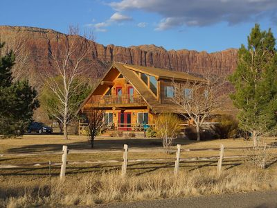 Photo for SENDERO - beautiful log home. 10 min from downtown Moab. Sleeps 17!  Huge yard!