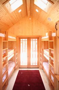The bunkhouse! 2 triple bunks, 1/2 bathroom & outdoor shower.