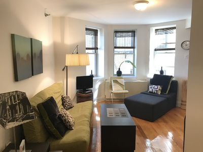Cozy sitting area with TV facing the kitchen & peak a boo views of hudson river.